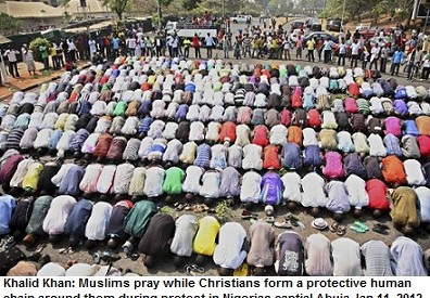 Muslims pray while Christians form a protective human chain around them during a protest against the elimination of a popular fuel subsidy that has doubled the price of petrol in Nigeria's captial Abuja